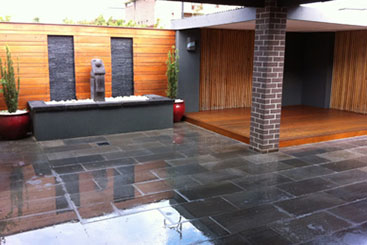 stone paving for outdoor area with feature wall and fountain